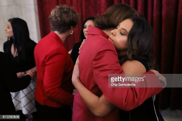 Former champion gymnast Mattie Larson embraces Sen Dianne Feinstein following a news conference with members of Congress in the Russell Senate Office...
