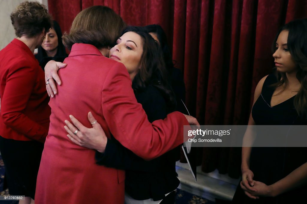 Former champion gymnasts Jamie Dantzscher embraces Sen. Dianne Feinstein (D-CA) following a news conference about new legislation to protect athletes in the Russell Senate Office Building on Capitol Hill January 30, 2018 in Washington, DC. Along with the gymnasts, all of whom are survivors of sexual abuse at the hands of coaches or trainers, the members of Congress were confident that the legislation would pass and 'require amateur athletics governing bodies to immediately report sex-abuse allegations to law enforcement and strengthen oversight of gymnasiums, amateur sports organizations, and coaches.'