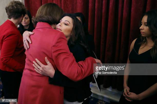 Former champion gymnasts Jamie Dantzscher embraces Sen Dianne Feinstein following a news conference about new legislation to protect athletes in the...