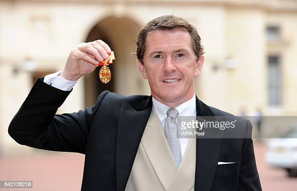 Former champion jockey Sir Anthony McCoy poses after he was made a Knight Bachelor by the Princess Royal during an investiture ceremony at Buckingham...