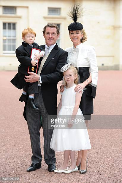 Former champion jockey Sir Anthony McCoy poses with family wife Chanelle daughter Eve and son Archie after he was made a Knight Bachelor by the...