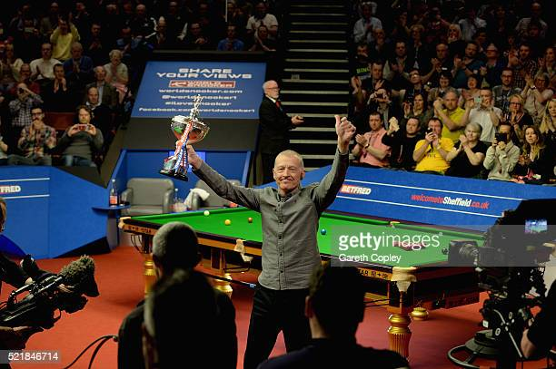 Former champion Steve Davis salutes the Crucible crowd with the World Snooker Championship trophy after announcing his retirement from the game at...