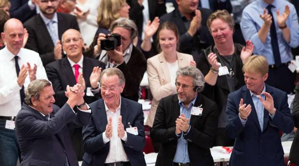 former chancellor gerhard schroder left to right being cheered on after his speech while - Gerhard Schroder Lebenslauf