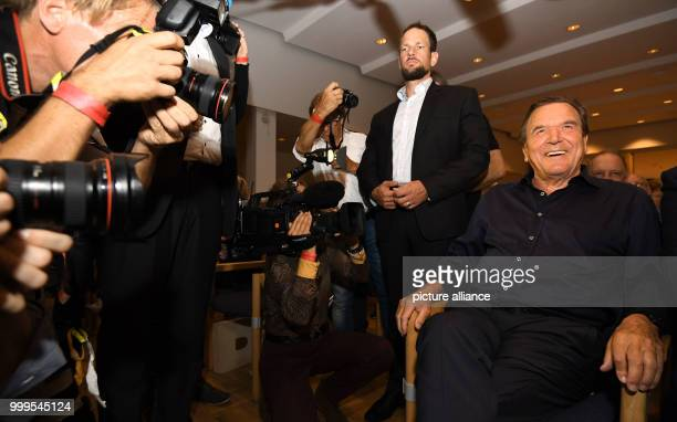 Former Chancellor Gerhard Schroder sitting in the first row surrounded by photographers during anSPDcampaign event in the Diakonie Hospital in...