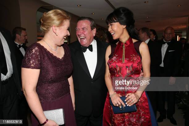 Former Chancellor Gerhard Schroeder and his wife Kim Soyeon and Minister for family Franziska Giffey during the 68th Bundespresseball at Hotel Adlon...