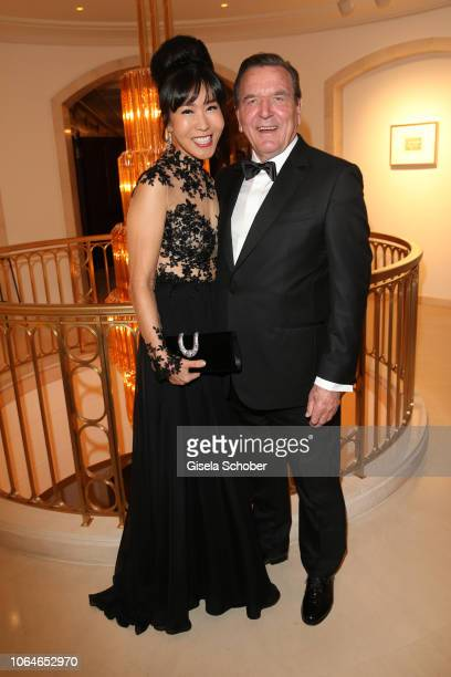 Former Chancellor Gerhard Schroeder and his wife Soyeon SchroederKim during the 67th Bundespresseball at Hotel Adlon on November 23 2018 in Berlin...