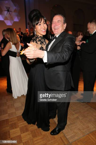 Former Chancellor Gerhard Schroeder and his wife Soyeon SchroederKim dance during the 67th Bundespresseball at Hotel Adlon on November 23 2018 in...