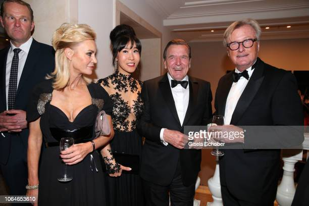Former Chancellor Gerhard Schroeder and his wife Soyeon SchroederKim Christiane Joerges and her husband HansUlrich 'Uli' Joerges during the 67th...