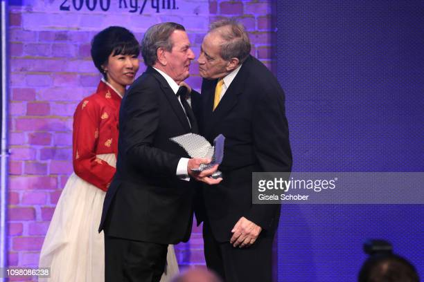 Former Chancellor Gerhard Schroeder and his wife Soyeon Schroeder-Kim and Arthur Cohn with award during the Cinema for Peace Gala at the Westhafen...