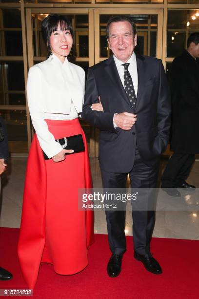 Former Chancellor of Germany Gerhard Schroder and his partner Soyeon Kim attend the IOC President's Dinner ahead of the PyeongChang 2018 Winter...