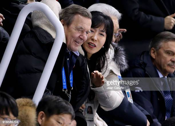 Former Chancellor of Germany Gerhard Schroeder and his South Korean partner Kim SoYeon attend the women's ice hockey preliminary match between Korea...