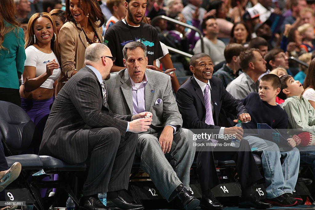 Former Charlotte Hornets Rex Chapman, Kelly Tripuka, and Muggsy Bogues during the game at the Time Warner Cable Arena on December 21, 2013 in Charlotte, North Carolina.
