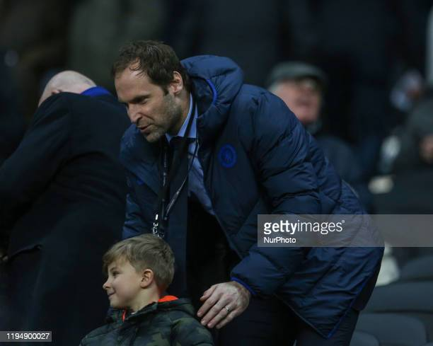 Former Chelsea goal kepper Petr Cech with a young fan during the Premier League match between Newcastle United and Chelsea at St James's Park...