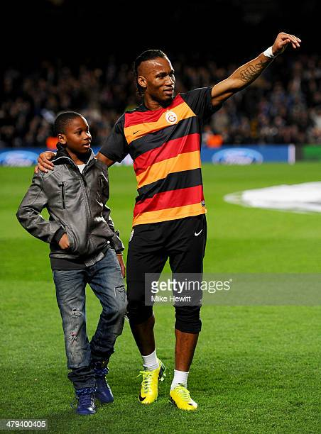 Former Chelsea player Didier Drogba of Galatasaray and son Isaac wave to the crowd prior to the UEFA Champions League Round of 16 second leg match...