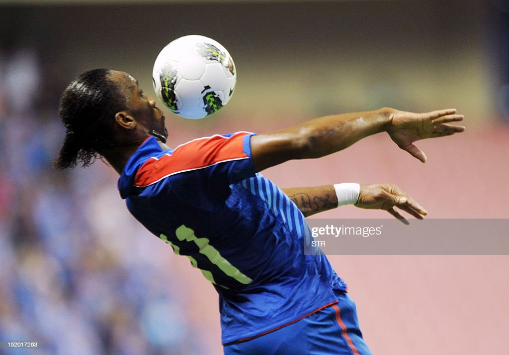 Former Chelsea star Didier Drogba of Shanghai Shenhua fields the ball, before his team beat Liaoning Whowin 3-0, in the Chinese Super League (CSL) match in Shanghai on September 15, 2012. The futures of Drogba and team-mate Anelka were put in doubt last month when a Shanghai newspaper claimed that eccentric owner Zhu Jun, who pays the huge wages of the star pair, had threatened to withdraw funding.