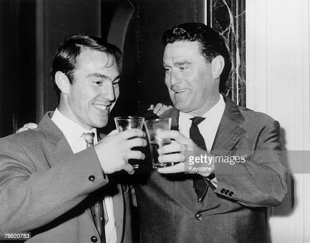 Former Chelsea striker Jimmy Greaves celebrates his arrival at the AC Milan football club with Italian coach Nereo Rocco after his transfer from...