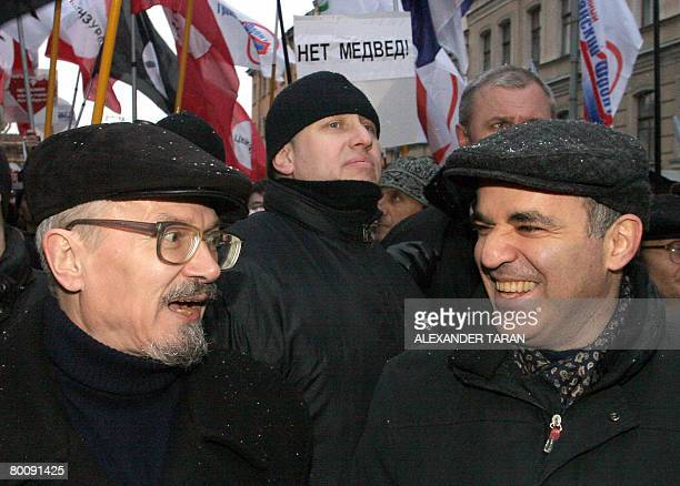 Former chess champion turned Kremlin critic Garry Kasparov speaks with the activist and counterculture writer Eduard Limonov during a rally of...
