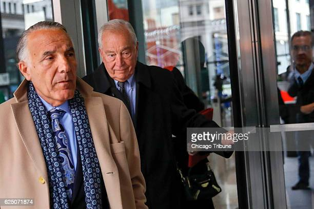 Former Chicago Ald Edward Vrdolyak center walks with attorney Michael Monico as they exit the the Dirksen US Courthouse on Tuesday Nov 22 2016 in...