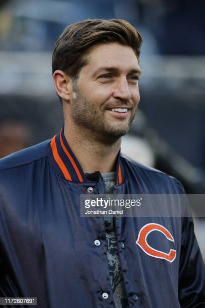 Former Chicago Bears quarterback Jay Cutler looks on before the game between the Green Bay Packers and the Chicago Bears at Soldier Field on...