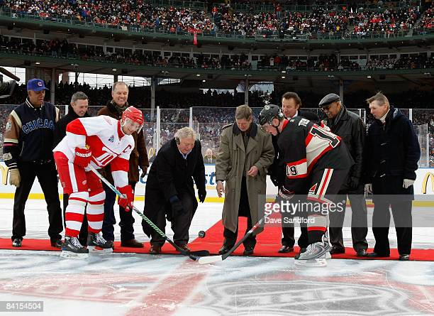 Former Chicago Blackhawk Bobby Hull and former Detroit Red Wing Ted Lindsay drop the cermonial puck during pregame ceremonies prior to the NHL Winter...