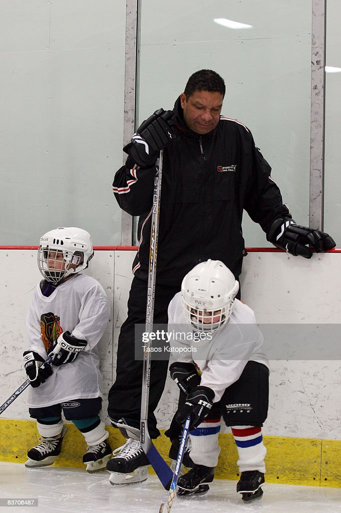 Former Chicago Blackhawk 's Tony McKegney works with kids at the AHAI Team Clinic November 15, 2008 in Glen Ellyn, Illinois.