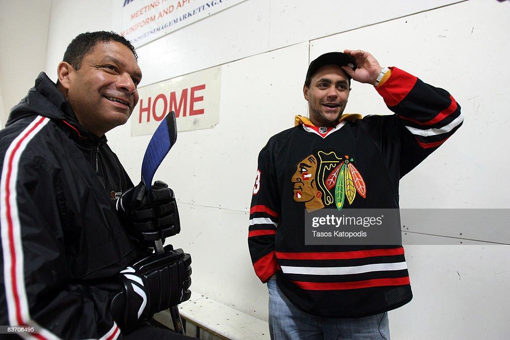 Former Chicago Blackhawk Tony McKegney and Chicago Blackhawk's Dustin Byfuglien great fans at the AHAI Team Clinic November 15, 2008 in Glen Ellyn, Illinois.