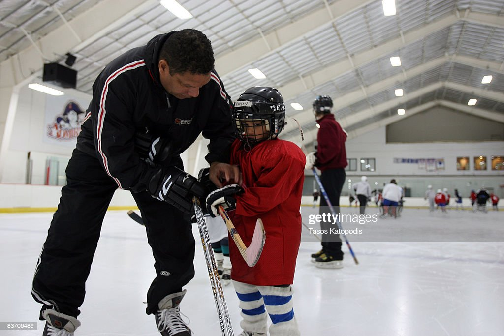 Former Chicago Blackhawk Tony McKegney works with kids at the AHAI Team Clinic November 15, 2008 in Glen Ellyn, Illinois.