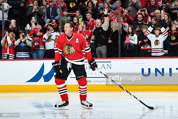 Former Chicago Blackhawks forward Jeremy Roenick is honored during the Blackhawks One More Shift campaign prior to the game against the Vancouver...