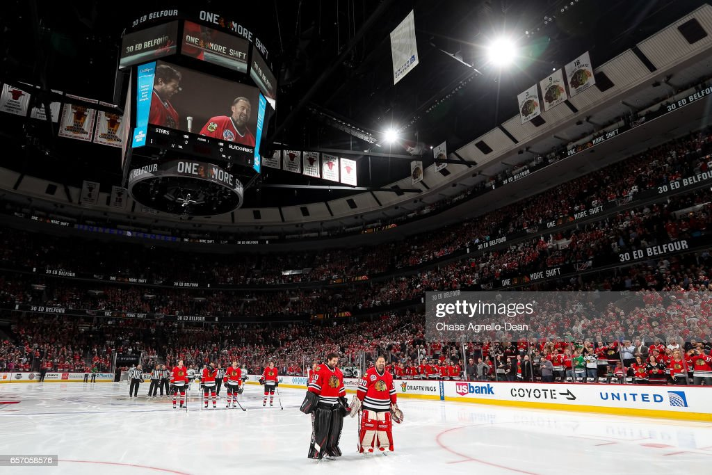 39109a0be Former Chicago Blackhawks goaltender Ed Belfour stands with Corey ...