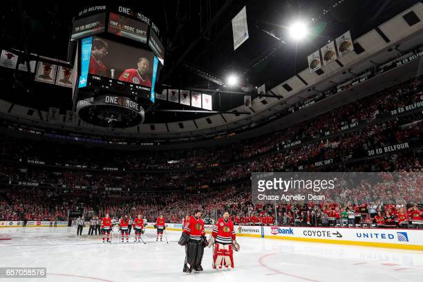 Former Chicago Blackhawks goaltender Ed Belfour stands with Corey Crawford of the Chicago Blackhawks during their 'One More Shift' campaign prior to...