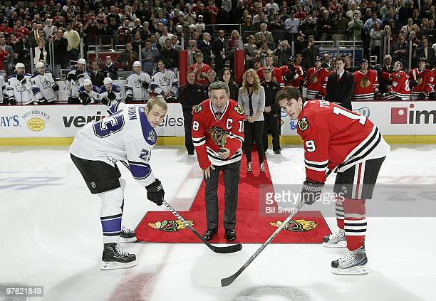 Former Chicago Blackhawks player and NHL Hall of Famer Denis Savard performs the ceremonial puck drop with captain Jonathan Toews of the Chicago...