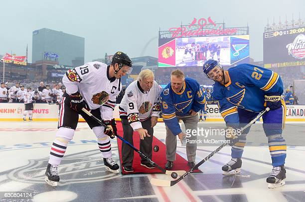 Former Chicago Blackhawks player Bobby Hull second from left and son former St Louis Blues player Brett Hull second from right drop the puck for the...