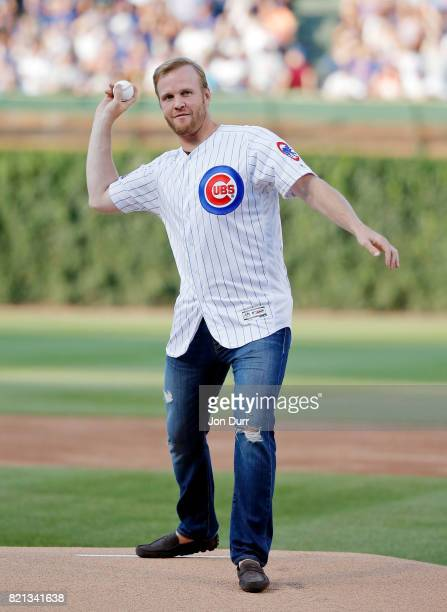 Former Chicago Blackhawks player Bryan Bickell throws out a ceremonial first pitch before the game between the Chicago Cubs and the St Louis...
