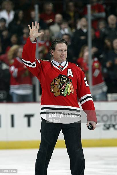 Former Chicago Blackhawks player Jeremy Roenick comes out on the ice to drop the ceremonial puck drop before the game against the San Jose Sharks on...