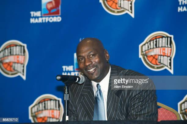 Former Chicago Bull guard Michael Jordan addresses the media after the Naismith Memorial Hall of Fame announced his induction to the class of 2009 at...