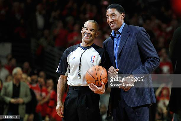 Former Chicago Bull player Scottie Pippen presents the game ball to referee Danny Crawford prior to the Chicago Bulls playing against the Miami Heat...