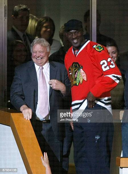 Former Chicago Bulls guard Michael Jordon stands with former Blackhawk and NHL Hall of Famer Bobby Hull as the Chicago Blackhawks play against the...