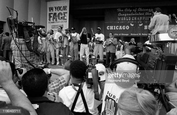 Former Chicago Bulls players Ron Harper Luc Longley Dennis Rodman Scottie Pippen coach Phil Jackson Michael Jordan and owner Jerry Reinsdorf stands...