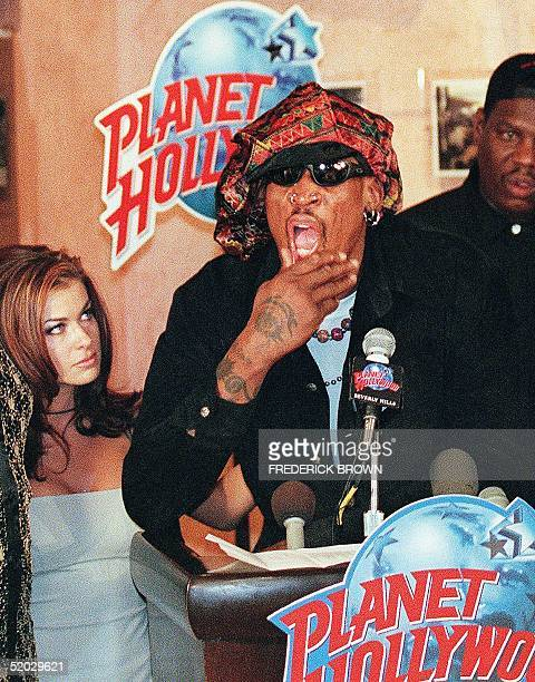 Former Chicago Bulls star Dennis Rodman speaks at a press conference 22 February in Beverly Hills accompanied by his wife Carmen Electra Rodman...