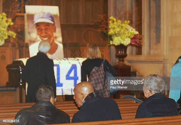 Former Chicago Cubs and teammates of Ernie Banks Jose Cardenal MLB Hall of Fame member Fergie Jenkins and Glenn Beckert sit in front of their temmate...
