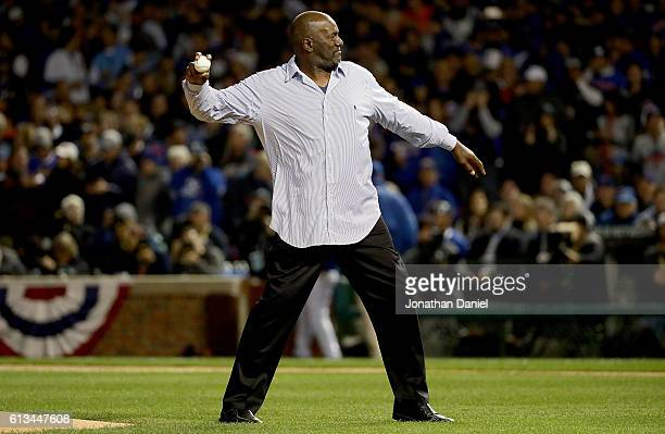 Former Chicago Cubs pitcher Lee Smith throws out the first pitch before the game between the Chicago Cubs and the San Francisco Giants at Wrigley...