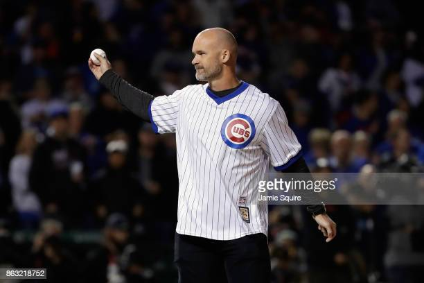 Former Chicago Cubs player David Ross throws out a ceremonial first pitch before game five of the National League Championship Series between the Los...