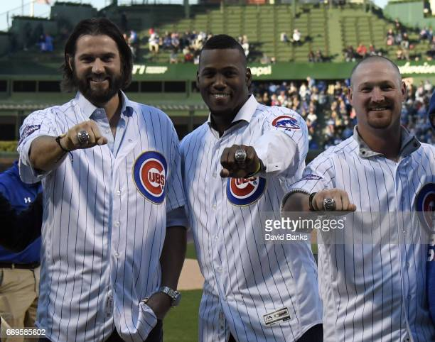 Former Chicago Cubs players Jason Hammel Jorge Soler and Travis Wood show off their 2016 World Series ring they received in a ceremony before the...