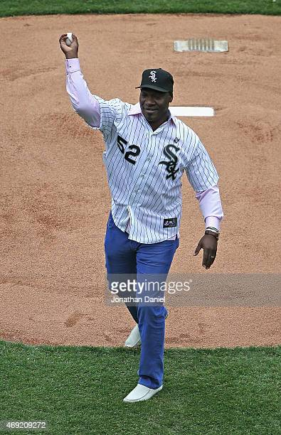 Former Chicago White Sox pitcher Jose Contreras throws out a ceremonial first pitch before the White Sox home opener against the Minnesota Twins at...