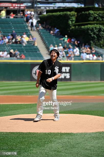 Former Chicago White Sox player Shingo Takatsu throws out the first pitch before the game between the Chicago White Sox and the Atlanta Braves on...