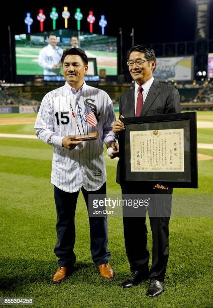 Former Chicago White Sox player Tadahito Iguchi is honored by Naoki Ito consul general of Japan in Chicago at Guaranteed Rate Field on September 28...