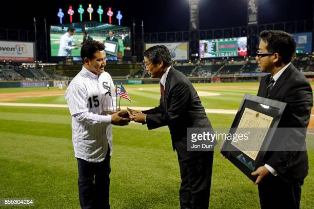 Former Chicago White Sox player Tadahito Iguchi is honored by Naoki Ito consul general of Japan in Chicago before the game between the Chicago White...