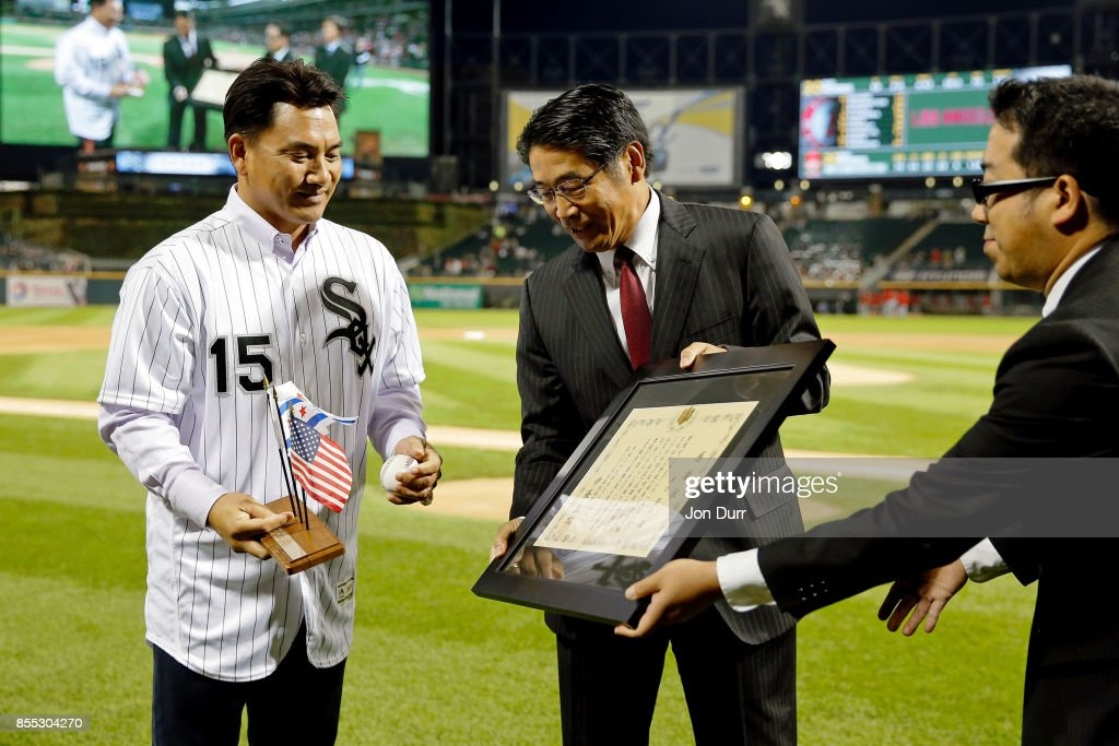 Former Chicago White Sox player Tadahito Iguchi (L) is honored by Naoki Ito, consul general of Japan in Chicago, before the game between the Chicago White Sox and the Los Angeles Angels of Anaheim at Guaranteed Rate Field on September 28, 2017 in Chicago, Illinois.