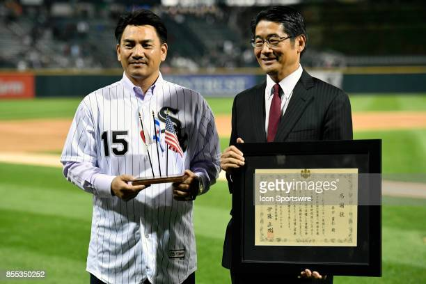 Former Chicago White Sox player Tadahito Iguchi is honored by Naoki Ito consul general of Japan in Chicago before the game between the Los Angeles...