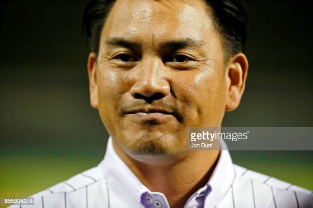 Former Chicago White Sox player Tadahito Iguchi looks on while he is honored by Naoki Ito consul general of Japan in Chicago before the game between...